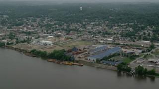 AX107_156 - 5K stock footage aerial video of warehouses along the river, Coraopolis, Pennsylvania