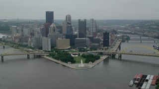 AX107_172 - 5K stock footage aerial video of Point State Park and skyscrapers, Downtown Pittsburgh, Pennsylvania