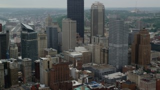 AX107_175 - 5K stock footage aerial video passing by skyscrapers, Downtown Pittsburgh, Pennsylvania