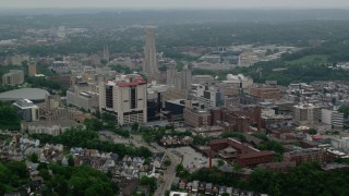 AX107_180 - 5K stock footage aerial video of the University of Pittsburgh and Cathedral of Learning, Pennsylvania