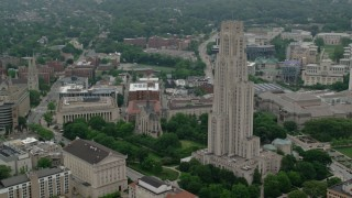 AX107_182 - 5K stock footage aerial video of Cathedral of Learning and Heinz Memorial Chapel, University of Pittsburgh, Pennsylvania