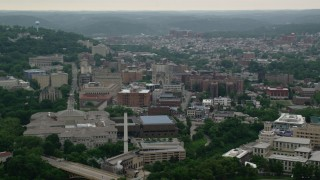 AX107_187 - 5K stock footage aerial video of University of Pittsburgh campus and Cathedral of Learning, Pennsylvania