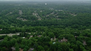 AX107_205 - 5K stock footage aerial video of suburban neighborhoods and forests, Penn Hills, Pennsylvania