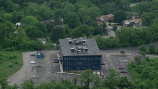 AX107_206 - 5K stock footage aerial video orbiting an office building, Pittsburgh, Pennsylvania