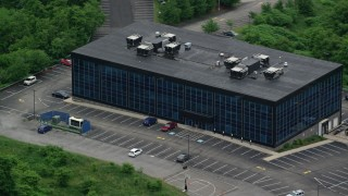 AX107_207 - 5K stock footage aerial video flying away from an office building, Pittsburgh, Pennsylvania