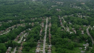 AX107_209 - 5K stock footage aerial video of suburban neighborhoods and trees, Penn Hills, Pennsylvania