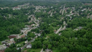 AX107_210 - 5K stock footage aerial video of suburban homes and trees, Penn Hills, Pennsylvania