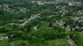 AX107_211 - 5K stock footage aerial video flying by homes, Penn Hills, Pennsylvania