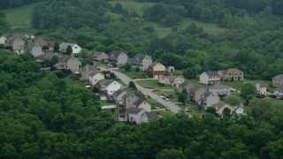 AX107_212 - 5K stock footage aerial video approaching a residential neighborhood, Penn Hills, Pennsylvania