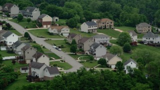 AX107_213 - 5K stock footage aerial video flying by a residential neighborhood, Penn Hills, Pennsylvania