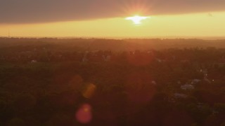 AX108_001 - 4K stock footage aerial video flying by residential neighborhood, Penn Hills, Pennsylvania, sunset