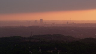AX108_007 - 4K stock footage aerial video of Downtown Pittsburgh skyline, Pennsylvania, sunset