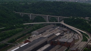 AX108_010 - 4K stock footage aerial video of George Westinghouse Bridge surrounded by trees, Pittsburgh, Pennsylvania