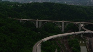 AX108_012 - 4K stock footage aerial video of George Westinghouse Bridge among trees, Pittsburgh, Pennsylvania