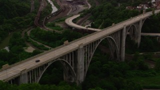 AX108_014 - 4K stock footage aerial video flying over light traffic on the George Westinghouse Bridge; Pittsburgh, Pennsylvania