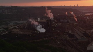 AX108_015 - 4K stock footage aerial video of the U.S. Steel Mon Valley Works, Braddock, Pennsylvania, sunset