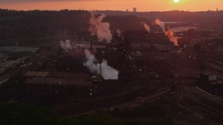 AX108_016 - 4K stock footage aerial video of U.S. Steel Mon Valley Works, Braddock, Pennsylvania, sunet