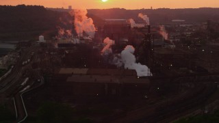 AX108_017 - 4K stock footage aerial video passing by U.S. Steel Mon Valley Works, Braddock, Pennsylvania, sunset