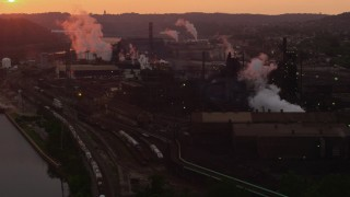 AX108_018 - 4K stock footage aerial video flying by U.S. Steel Mon Valley Works, Braddock, Pennsylvania, sunset
