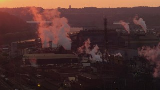 AX108_020 - 4K stock footage aerial video of the U.S. Steel Mon Valley Works and smoke stacks, Braddock, Pennsylvania, sunset