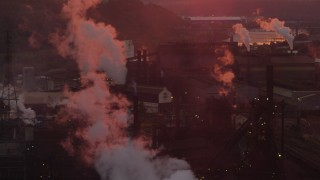 AX108_021 - 4K stock footage aerial video of the U.S. Steel Mon Valley Works and smoke stacks, Braddock, Pennsylvania, sunset