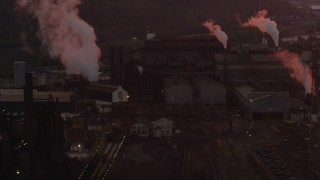 AX108_022 - 4K stock footage aerial video passing by U.S. Steel Mon Valley Works buildings, Braddock, Pennsylvania, sunset