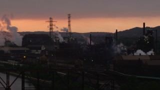 AX108_029 - 4K stock footage aerial video of U.S. Steel Mon Valley Works, Braddock, Pennsylvania, sunset