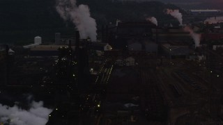 AX108_037 - 4K stock footage aerial video of U.S. Steel Mon Valley Works, Braddock, Pennsylvania, twilight