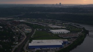 AX108_043 - 4K stock footage aerial video of Downtown Pittsburgh seen from warehouses, Munhall, Pennsylvania, twilight
