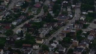 AX108_045 - 4K stock footage aerial video orbiting an urban neighborhood, Pittsburgh, Pennsylvania, twilight