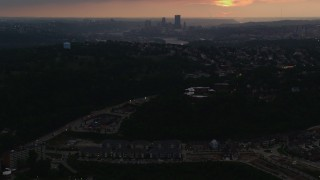 AX108_046 - 4K stock footage aerial video of Downtown Pittsburgh skyline from a distance, Pennsylvania, sunset