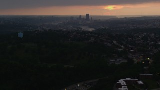 AX108_047 - 4K stock footage aerial video of Downtown Pittsburgh skyline from a distance, Pennsylvania, sunset