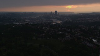 AX108_048 - 4K stock footage aerial video of Downtown Pittsburgh skyline from a distance, Pennsylvania, sunset