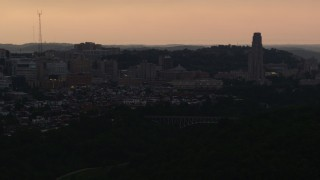 AX108_051 - 4K stock footage aerial video of the University of Pittsburgh campus, Pennsylvania, sunset