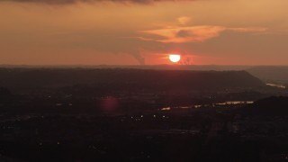 AX108_061 - 4K stock footage aerial video of the Ohio River and setting sun seen from Downtown Pittsburgh, Pennsylvania, sunset