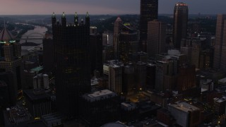 AX108_068 - 4K stock footage aerial video of PPG Place skyscrapers, Downtown Pittsburgh, twilight