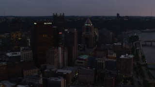 AX108_073 - 4K stock footage aerial video of Downtown Pittsburgh skyscrapers, Pennsylvania, twilight