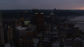 AX108_074 - 4K stock footage aerial video of Gulf Tower and skyscrapers, Downtown Pittsburgh, Pennsylvania, twilight