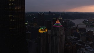 AX108_075 - 4K stock footage aerial video flying by Gulf Tower and U.S. Steel Tower, Downtown Pittsburgh, Pennsylvania, twilight