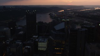 AX108_084 - 4K stock footage aerial video approaching PPG Place revealing Point State Park, Downtown Pittsburgh, Pennsylvania, twilight