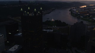 AX108_085 - 4K stock footage aerial video flying by PPG Place toward Point State Park, Downtown Pittsburgh, Pennsylvania, twilight