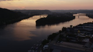 AX108_092 - 4K stock footage aerial video of Brunot Island on the Ohio River, Pittsburgh, Pennsylvania, twilight