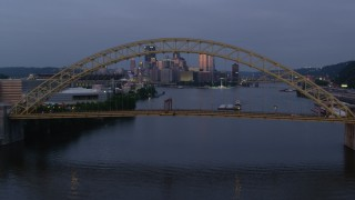 AX108_094 - 4K stock footage aerial video flying over West End Bridge toward Downtown Pittsburgh, Pennsylvania, twilight