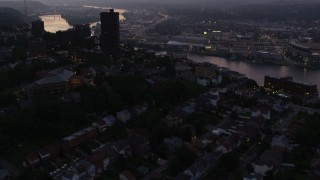 AX108_105 - 4K stock footage aerial video flying over suburban neighborhoods and office buildings above Ohio River, Pittsburgh, Pennsylvania, twilight