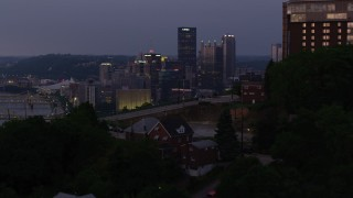 AX108_110 - 4K stock footage aerial video approaching Downtown Pittsburgh, tilting down on Point State Park, Pennsylvania, twilight