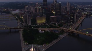 AX108_111 - 4K stock footage aerial video of Fort Duquesne at Point State Park, Downtown Pittsburgh, Pennsylvania, twilight