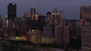 AX108_114 - 4K stock footage aerial video of Downtown Pittsburgh skyscrapers from Allegheny River, Pennsylvania, twilight