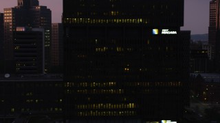 AX108_125 - 4K stock footage aerial video of skyscrapers, office buildings and city streets, Downtown Pittsburgh, Pennsylvania, twilight