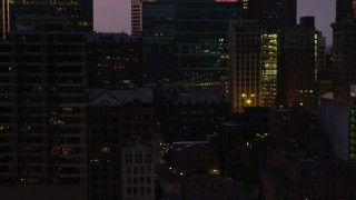 AX108_126 - 4K stock footage aerial video of skyscrapers and office buildings, Downtown Pittsburgh, Pennsylvania, twilight