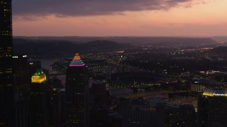 AX108_134 - 4K stock footage aerial video of PNC Park and bridges spanning the Allegheny River, Downtown Pittsburgh, twilight
